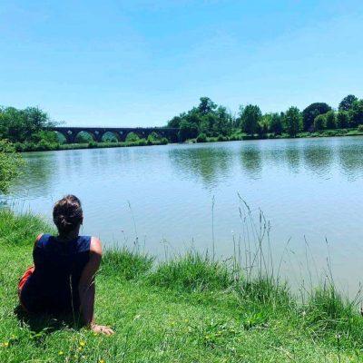 Unwinding along the lake's embankment